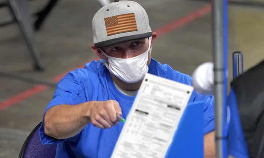 Maricopa County ballots cast in the 2020 general election being examined and recounted by contractors working for Florida-based company, Cyber Ninjas, in Phoenix in May.