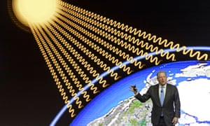 Al Gore presenting in front of an image of the globe