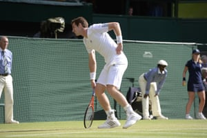 Andy Murray grimaces as he holds his hip at Wimbledon in 2013.