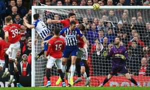 Lewis Dunk, second left, hits back with a headed goal for Brighton at Old Trafford.