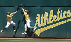 Oakland Athletics fielders Billy Burns, left, and Josh Reddick are part of a sputtering, unlucky A's team