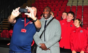 Sol Campbell, the new manager of Macclesfield Town, poses for a picture with Exeter City mascots before the match.
