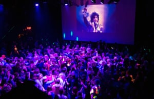 Minnesota, US Guests dance to Prince music as a slide show flashes images of the artist above the stage during a memorial dance party at the First Avenue nightclub.