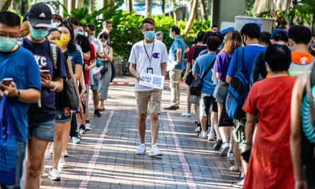 People wait to vote in Hong Kong's primary elections for pro-democracy parties, seen as a snub to Beijing's new national security laws. China declared the polls illegal.