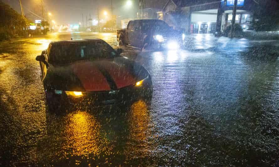 Motorists navigate a flooded street in Slidell, Louisiana.