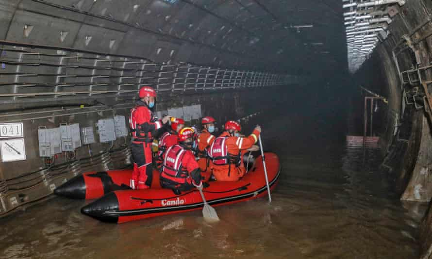 Rescuers searching inside the flooded Zhengzhou subway on 26 July.