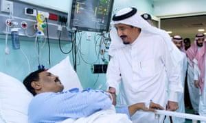 King Salman of Saudi Arabia visits wounded man in Mecca