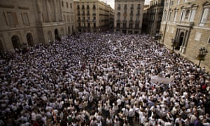People rally in Sant Jaume Square in Barcelona.