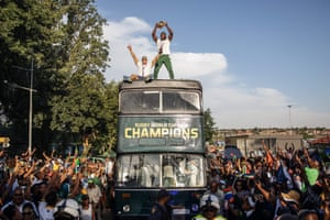 South Africa captain Siya Kolisi holds up the Web Ellis trophy as the Rugby World Cup winners parade on an open top bus in Soweto.