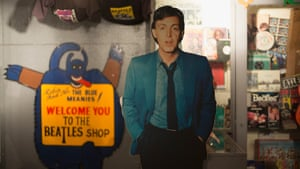 A cardboard cutout of Sir Paul McCartney alongside other memorabilia and merchandise displayed in a shop in Liverpool