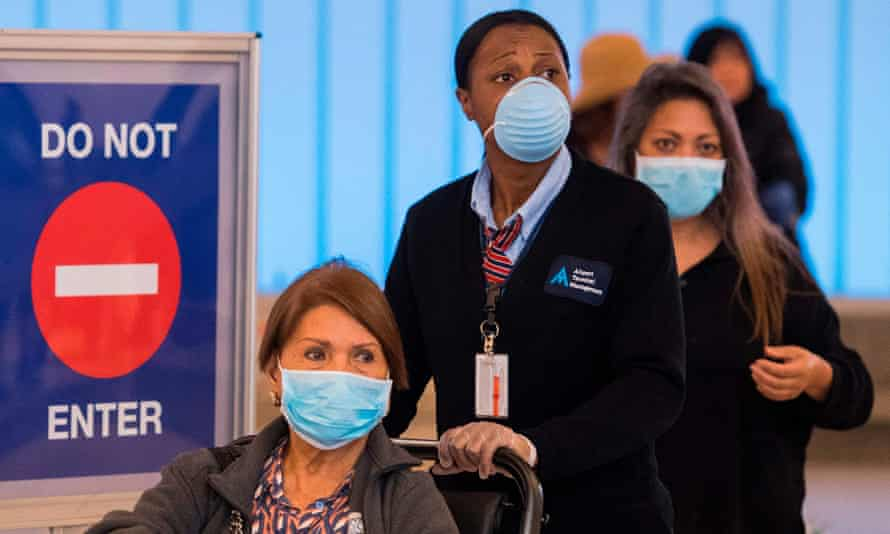 Passengers wear face masks to protect against coronavirus at Los Angeles airport.
