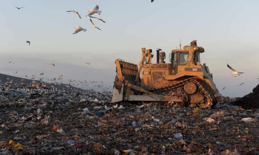 A bulldozer moves garbage in a landfill cell at the Melbourne Regional Landfill site, operated by at Cleanaway Waste Management Ltd., in Ravenhall, Victoria.