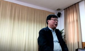 A still from the video in which Gui Minhai delivers his staged confession
