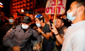 Israeli police officers remove protesters from the street in Jerusalem.
