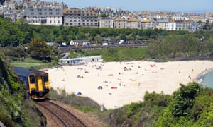 Train leaving Porthminster and Porthminster beach in St Ives, Cornwall