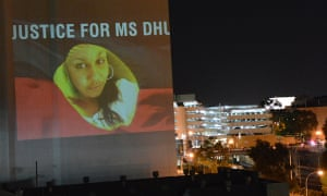 An image of the Yamatji woman Ms Dhu, who died in police custody, is projected on to buildings in Perth, Western Australia, before the coronial inquest into her death in March 2016.