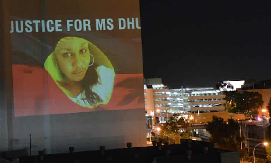 An image of the Yamatji woman Ms Dhu, who died in police custody, is projected on to buildings in Perth