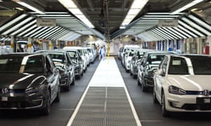 New Volkswagen cars are lined up at the country's manufacturing plant in Wolfsburg, central Germany.