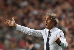 Roberto Mancini cuts a frustrated figure in Portugal.