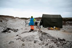 A Zimbabwean takes a break while working on a mined beach in Stanley