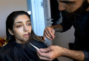 Zeinab uses makeup to disguise herself as a man.