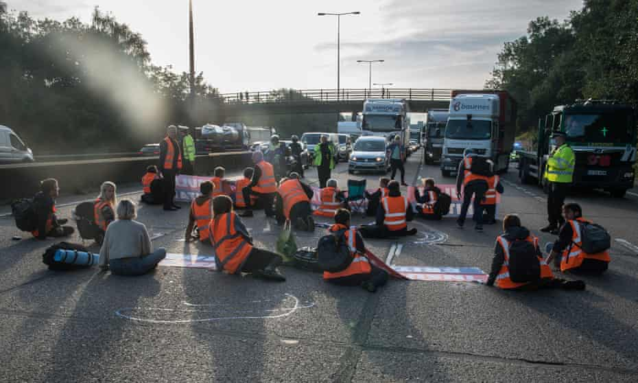 Protesters from Insulate Britain block the M25 motorway near Cobham in Surrey