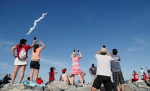 Spectators watch SpaceX's first Falcon Heavy rocket launches from the Kennedy Space Center in FloridaSpectators at Cocoa Beach watch SpaceX's first Falcon Heavy rocket launch from the Kennedy Space Center, Florida, U.S., February 6, 2018. REUTERS/Gregg Newton