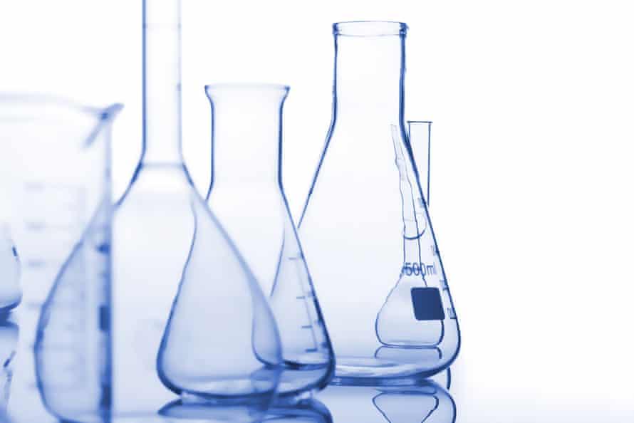 Blue medical flasks against white background