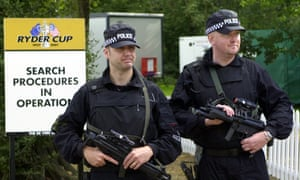 British police officers stand guard at the entrance to the Belfry golf course at the 2002 Ryder Cup