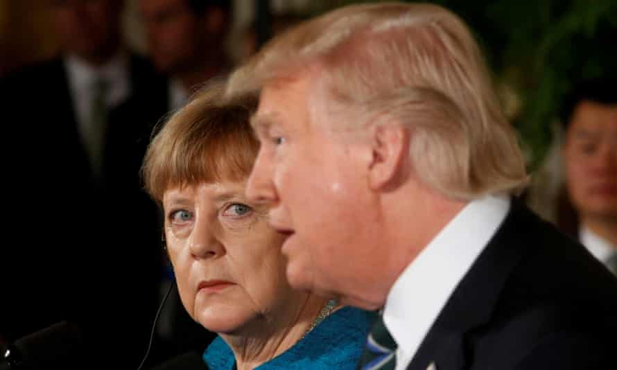 Angela Merkel watches as President Donald Trump speaks in the East Room of the White House.