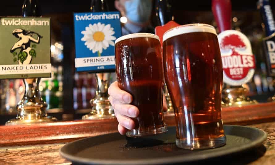 A barman pours pints