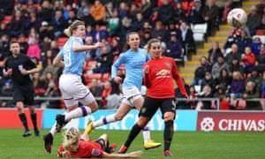 Manchester City's Ellen White (left) scores her side's second goal against Manchester United in the FA Cup fourth round.