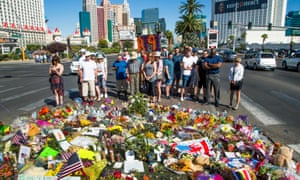 People visit a memorial in the middle of Las Vegas Boulevard, across from the scene of the attack.