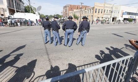 Alabama state troopers stand near the Edmund Pettus Bridge.