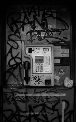 A vandalised phone box next to Brixton tube station