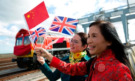 People wave a Chinese and a Union flag in Corringham, east of London.