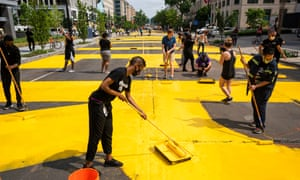 With permission from the city, volunteers paint 'Black Lives Matter' on 16th St across from the White House on Friday.