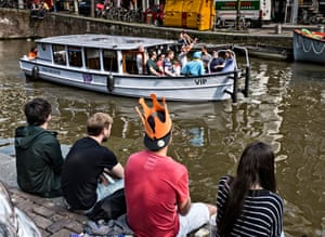 Tourists sail in downtown Amsterdam