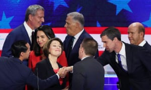 Democratic presidential candidates mingle after the first debate in Miami.