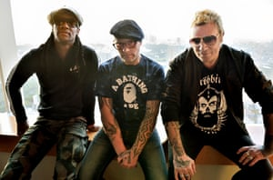 Flint, centre, with Liam Howlett and Maxim in Tokyo, 2015