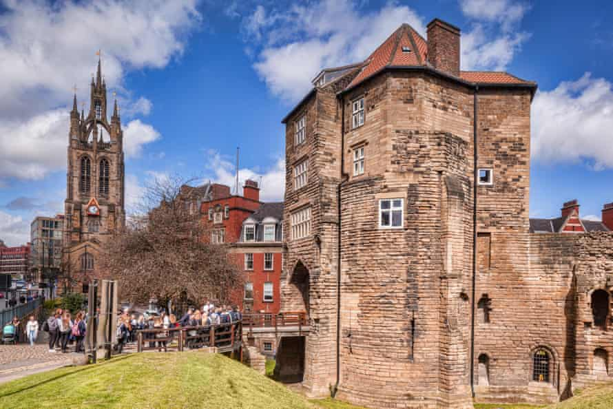 The Black Gate, entrance to old Newcastle, with a party of students waiting to go inside. On the left is Newcastle Cathedral