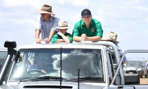 Agriculture minister David Littleproud and prime minister Scott Morrison on the back of a ute during a visit to a drought-affected property near Dalby, Queensland, 27 September 2019
