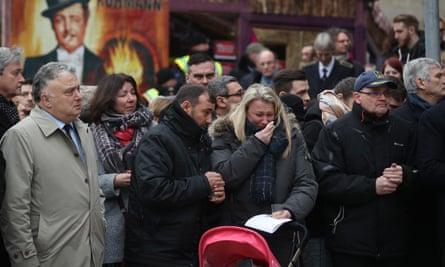 People attend a memorial the memorial.