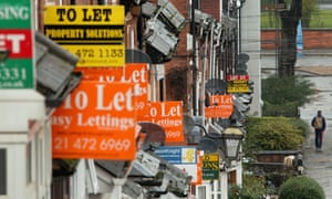 An array of To Let and For Sale signs protrude from houses