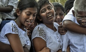 Mourners grieve at the graves of relatives killed in the Easter Sunday bombingsin Sri Lanka. Journalists question their presence at deeply personal times such as these.