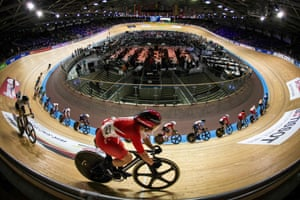 Japan's Yumi Kajihara peruses the field as she cycles around the top of the banking during the women's omnium scratch race