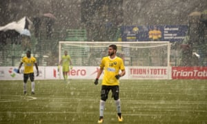 Snow falls on Real Kashmir's Danish Farooq during their I-League club football match against Gokulam Kerala FC at the Tourist Reception Centre football ground in Srinagar in February 2019.