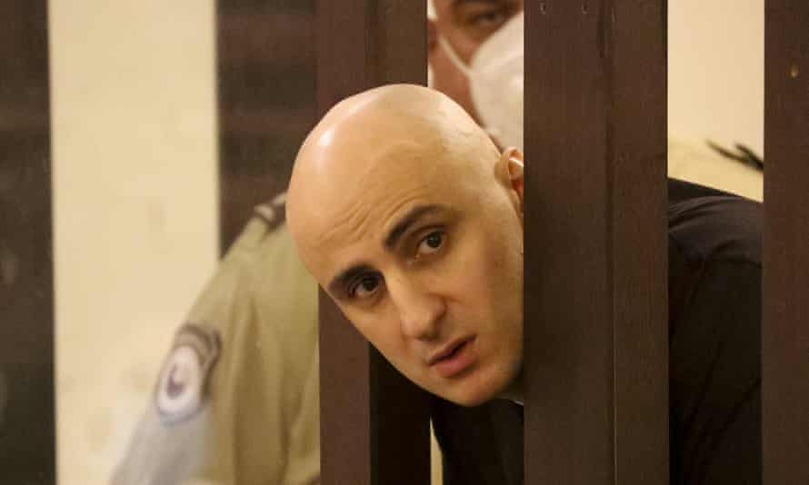 Nika Melia, chair of the United National Movement, looks through the bars in a courtroom in Tbilisi, in April.