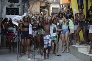 Youths protest a police operation targeting drug traffickers in the Jacarezinho favela of Rio de Janeiro.