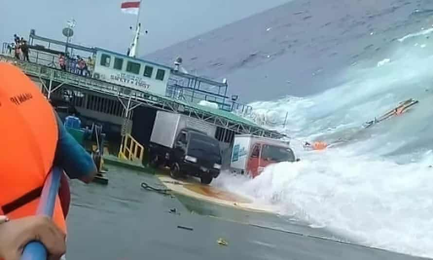 Vehicles slide off the ferry as it sinks.